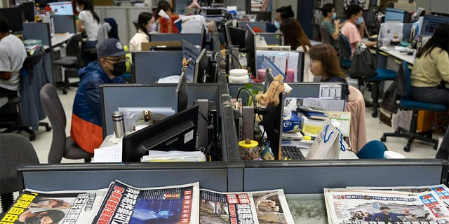 Reporters work at the news room of Apple Daily Monday, April 26, 2021, in Hong Kong.
