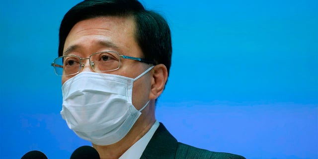 Hong Kong Secretary for Security, John Lee listens to questions during a press conference in Hong Kong, Thursday, June 17, 2021.
