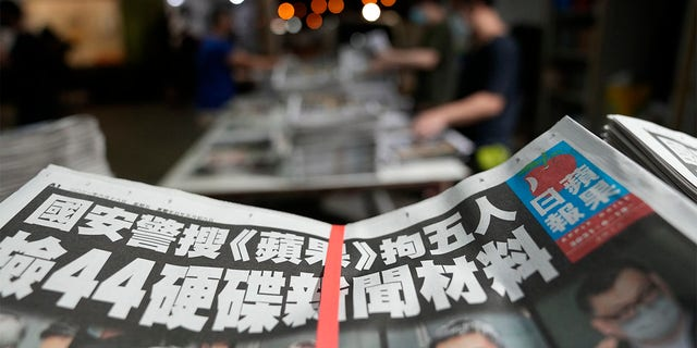 Copies of Apple Daily newspaper are packed at the printing house in Hong Kong, early Friday, June 18, 2021.