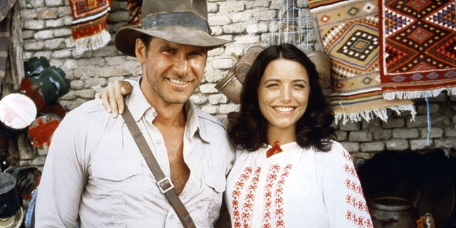 Harrison Ford and actress Karen Allen on the set of 'Raiders of the Lost Ark'.