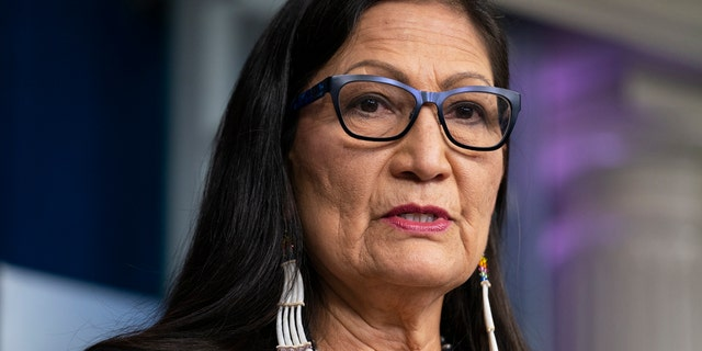 FILE - In this April 23, 2021, file photo, Interior Secretary Deb Haaland speaks during a news briefing at the White House in Washington. On Tuesday, June 22, 2021, Haaland and other federal officials are expected to announce steps that the federal government plans to take to reconcile the legacy of boarding school policies on Indigenous families and communities across the U.S. (AP Photo/Evan Vucci, File)