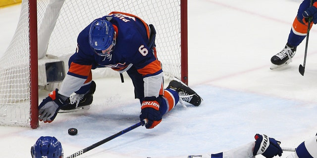 New York Islanders defenseman Ryan Pulock (6) makes a last second save to secure the victory against the Tampa Bay Lightning during the third period of game four of the 2021 Stanley Cup Semifinals at Nassau Veterans Memorial Coliseum, June 19, 2021. (USA TODAY Sports)