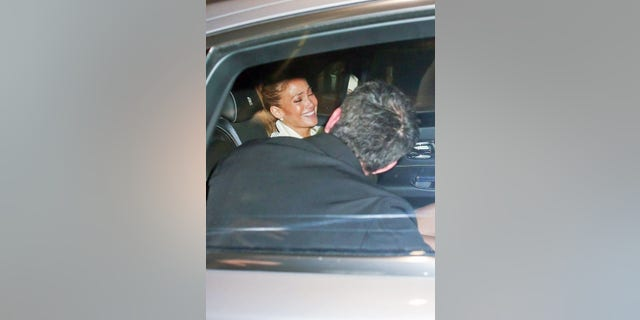 Jennifer Lopez erupts in laughter while having fun with Ben Affleck in the back seat on their way to dinner in Beverly Hills.