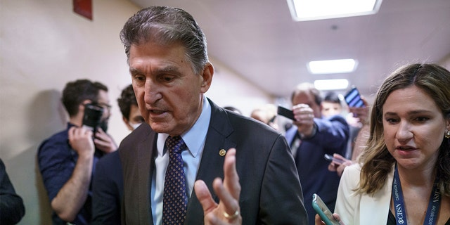Senator Joe Manchin, DW.Va., a decisive 50th vote for Democrats on President Biden's proposals, goes to reporters while Senators vote before the upcoming Memorial Day recess at the Capitol in Washington, Thursday, May 27 go, 2021. (AP Photo / J. Scott Applewhite)