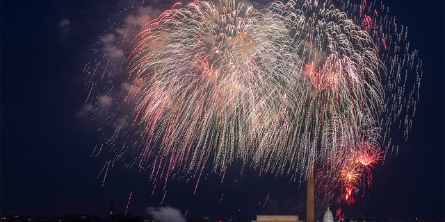 FILE - In this Saturday, July 4, 2020, file photo, Fourth of July fireworks explode over the Lincoln Memorial, the Washington Monument and the U.S. Capitol along the National Mall in Washington. (AP Photo/Cliff Owen, File)