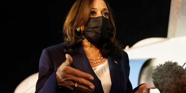 June 7, 2021: Vice President Kamala Harris talks to the press gathered under the wing of Air Force Two as she prepares to depart for Mexico, from Guatemala's Air Force Central Command. (AP Photo/Jacquelyn Martin)