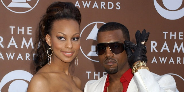 Kanye West and Brooke Crittendon.  (Photo by Gregg DeGuire / WireImage for Recording Academy)