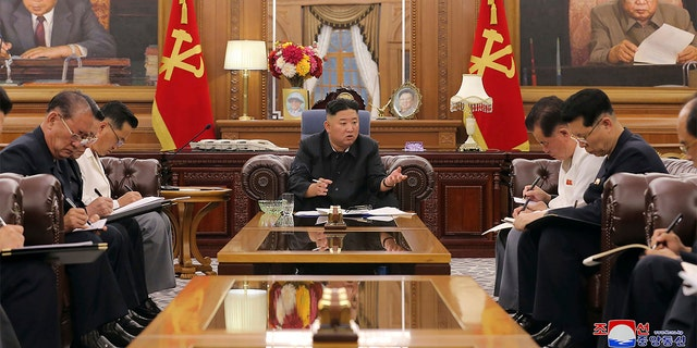 In this photo provided by the North Korean government, North Korean leader Kim Jong Un, center, attends a meeting with senior ruling party officials in Pyongyang, Monday, June 7, 2021.