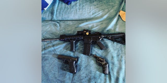 Eriz's alleged public instagram profile includes this picture of a rifle and two handguns.