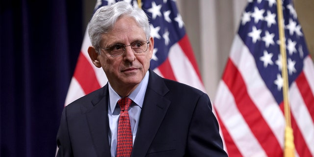 Attorney General Merrick Garland departs after speaking at the Justice Department in Washington, on Tuesday, June 15, 2021. Garland sparked outrage with a memo many Republicans interpreted as an invitation for the FBI to begin investigating concerned parents at school board meetings. (Win McNamee/Pool via AP)