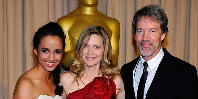 Michelle Pfeiffer (center) with her husband David E. Kelley and daughter Claudia Rose at the 2010 Academy Awards. (Photo by Kevork Djansezian/Getty Images)
