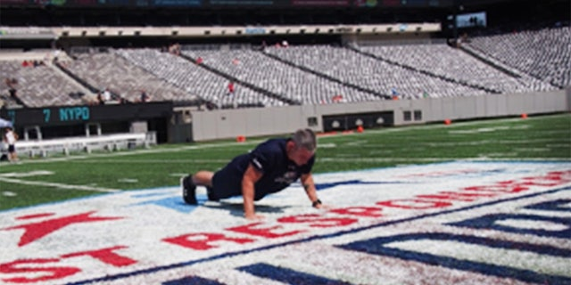 Nate Carroll on the 50-yard line of MetLife Stadiumin New Jersey broke the record in front of first responders. (Tunnels to Towers Foundation)