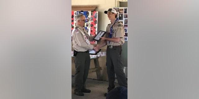 Mychal VanAllsburg getting the Heroism Award for saving Jodie Matthews in the 2018 crash.