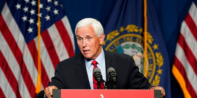 Former Vice President Mike Pence speaks at the annual Hillsborough County NH GOP Lincoln-Reagan Dinner, Thursday, June 3, 2021, in Manchester, N.H. (AP Photo/Elise Amendola)
