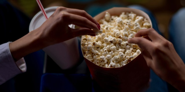 TikTok user Colleen Lepp posted a video showing people how to make sure butter gets all throughout their popcorn buckets, rather than just on the top. (iStock)