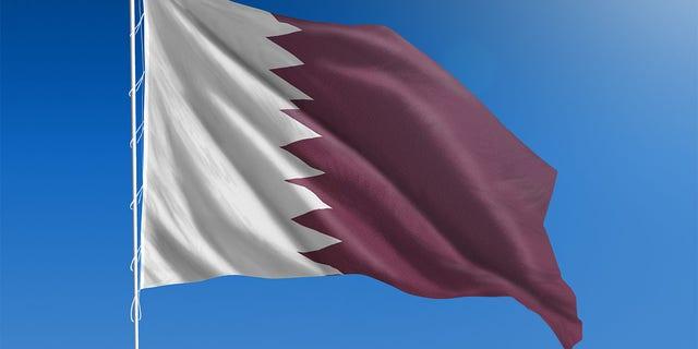 The National flag of Qatar.