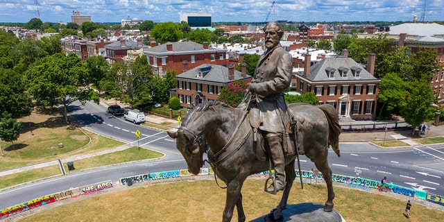 In this Friday, July 10, 2020, file photo is the statue of Confederate General Robert E. Lee Monument Avenue in Richmond, Va. (AP Photo/Steve Helber, File)