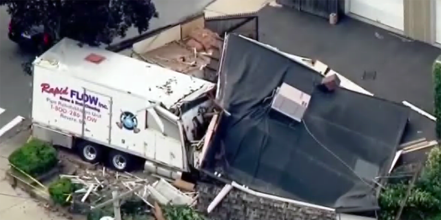 Aerial footage over the scene showed the truck crashed into the side of the structure in Winthrop.