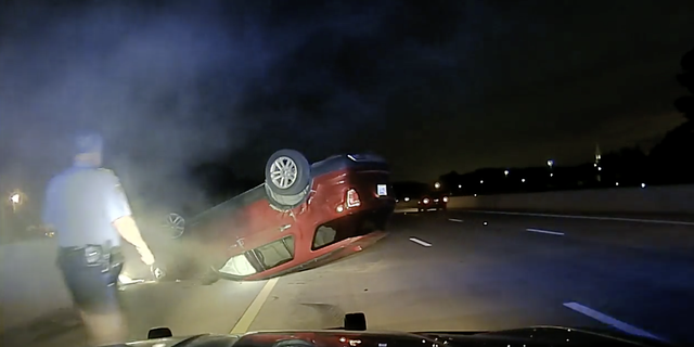 After the PIT maneuver, Harper's car came to a stop upside down in the middle of the highway.