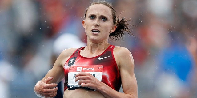 Houlihan, the American record holder in the 1,500 and 5,000 meters, posted on social media that she's been banned for four years following a positive test for what she concluded was a tainted pork burrito. Houlihan said she received an email from the Athletics Integrity Unit (AIU) on Jan. 14, 2021, notifying her that a drug testing sample returned a finding for the anabolic steroid nandrolone. (AP Photo/Charlie Neibergall, File)