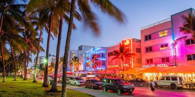 Pedestrians and traffic pass through Ocean Drive. The road is the main thoroughfare through South Beach and is known for distinctive art deco architecture.