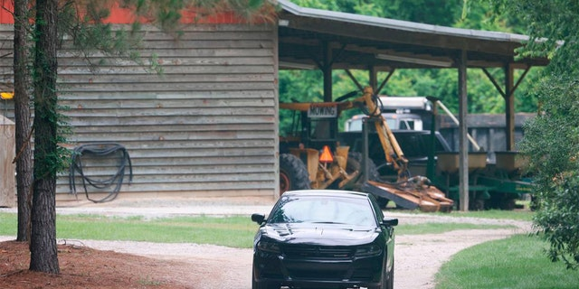 A vehicle sits in the driveway of a home, Tuesday, June 8, 2021, in rural Colleton County, near Islandton, S.C. A mother and son from a prominent South Carolina legal family were found shot and killed on the family's land, and authorities said they have made no arrests in the double homicide case.