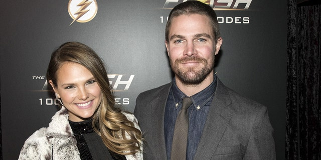 Stephen Amell was reportedly kicked off a flight after getting into a verbal altercation with his wife, Cassandra Jean Amell.