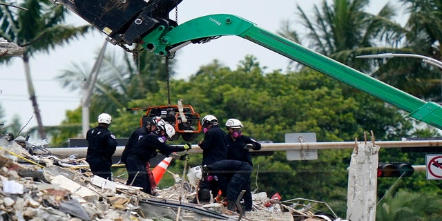Crews work in the rubble of Champlain Towers South residential condo on Tuesday. (AP)