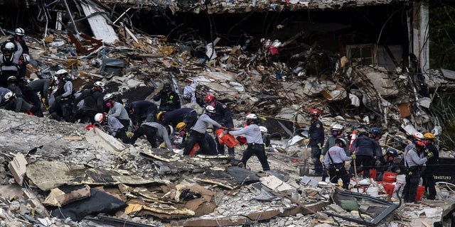 Search and rescue teams look for survivors at the Champlain Towers South residential condo on Tuesday. (AP/Miami Herald)