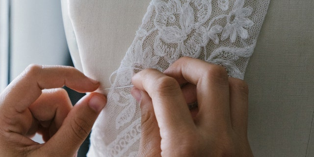 Bridal knitwear designer Esther Andrews hand-knit her own wedding dress and documented the experience on TikTok. (iStock)
