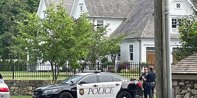 Westport, Connecticut, police officers are seen Friday outside a home where a mother and daughter were found dead Thursday. (Connor Ryan/Fox News)