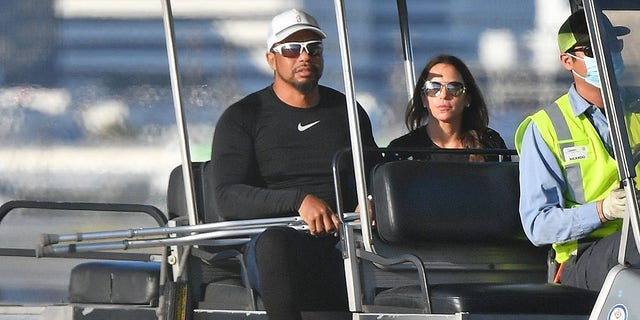 Woods, who is not yet driving, was pictured in a golf cart with his girlfriend Erica Herman.  (Image directly / BACKGRID USA)