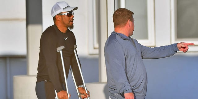 Woods was still seen on crutches as he recovered.  (Image directly / BACKGRID USA)