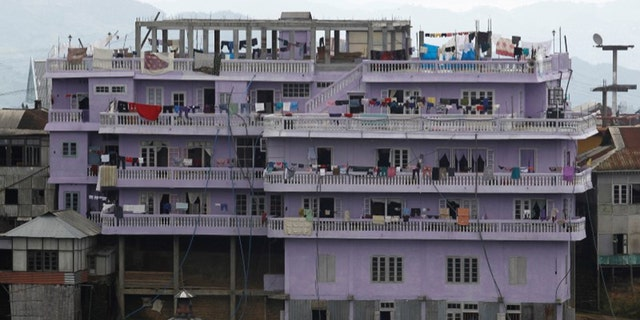 FILE PHOTO: A view of Ziona's 4 storey house in Baktawng village in the northeastern Indian state of Mizoram, October 6, 2011. REUTERS/Adnan Abidi