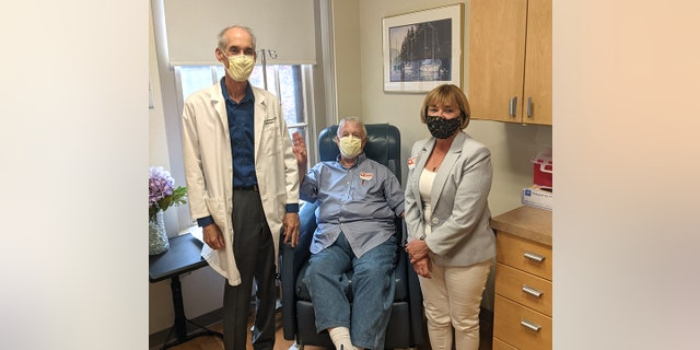 Dr. Stephen Salloway, director of the memory and aging program at Butler Hospital, patient Marc Archambault, and Marc's friend Karen Poole. (Photo courtesy of Care New England Health System and Butler Hospital)