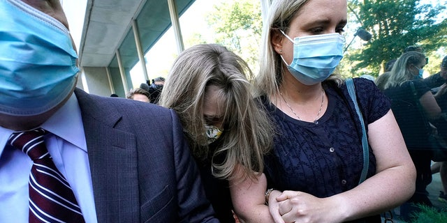 German-born American TV actress Allison Mack(C) arrives at Brooklyn Federal Court on June 30, 2021 in New York, to be sentenced for her role in the alleged sex cult NXIVM.