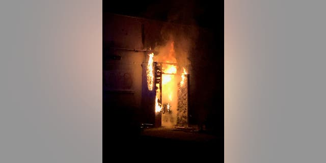 Flames are seen at the Portland Police Association's headquarters in the city's Kenton neighborhood. (Portland Police Association)