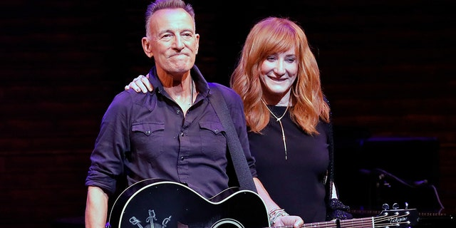 """Bruce Springsteen and Patti Scialfa take a bow during reopening night of """"Springsteen on Broadway"""" for a full-capacity, vaccinated audience at St. James Theatre on June 26, 2021 in New York City."""
