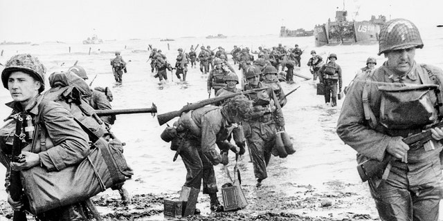 NOSOTROS. Assault Troops land on Omaha beach during the Invasion of Normandy on June 6, 1944. (Keystone/Getty Images)
