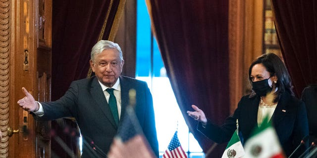 June 8, 2021: Vice President Kamala Harris and Mexican President Andres Manuel Lopez Obrador arrive for a bilateral meeting at the National Palace in Mexico City. (AP Photo/Jacquelyn Martin)