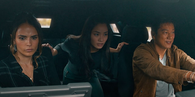 """This image released by Universal Pictures shows Jordana Brewster, 从左起, Anna Sawai and Sung Kang in a scene from """"F9: The Fast Saga."""""""