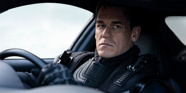 """This image released by Universal Pictures shows John Cena in a scene from """"F9: The Fast Saga."""""""