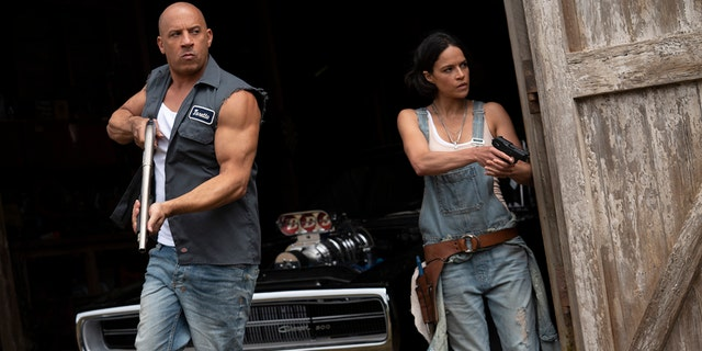 """This image released by Universal Pictures shows Vin Diesel, 剩下, and Michelle Rodriguez in a scene from """"F9: The Fast Saga."""""""
