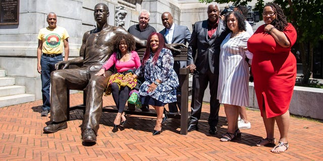 The George Floyd statue was unveiled outside Newark's city hall Wednesday by Mayor Ras J. Baraka, fillmmaker Leon Pickney, sculptor Stanley Watts, and other city officials.