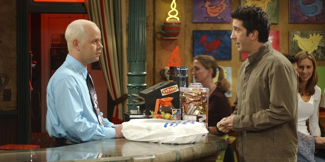 "Pictured: (l-r) James Michael Tyler as Gunther, David Schwimmer as Ross Geller on ""Friends"""
