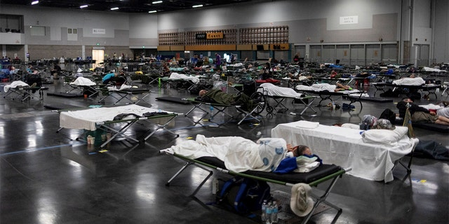 People sleep at a cooling shelter set up during an unprecedented heat wave in Portland, Oregon, U.S. June 27, 2021. (REUTERS/Maranie Staab)