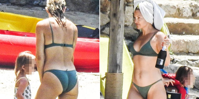 Kate Hudson and Danny Fujikawa, seen with the actresses' daughter Rani Rose and son Bingham, have fun at the beach in Greece. They drank some champagne and shot some selfies.