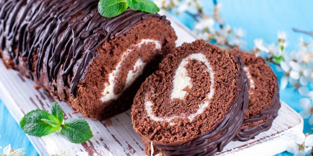 A Swiss roll is typically made from a cream- or jelly-covered sheet cake that's been rolled into the shape of a log. The two layers create a swirling design within the dessert's interior. (iStock)