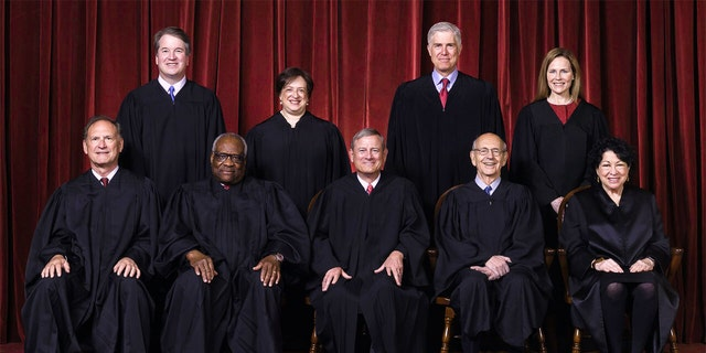In this April 23, 2021, file members of the Supreme Court making a group photo at the Supreme Court in Washington.  Seated from left are Justice Justice Al Alito, Clerk Judge Clarence Thomas, Counsel Judge John Roberts, Combine Judge Stephen Breyer and Combine Justice Sonia Sotomayor, Standing from left are Counsel Justice Brett Kavanaugh, Combine Justice Elena Kagan, Combine Justice Neil Gorsuch and B Merch.  Amy Coney Barrett.  Kavanaugh will be released from court Monday due to the COVID-19 investigation.  (Erin Schaff / The New York Times via AP, Pool, File