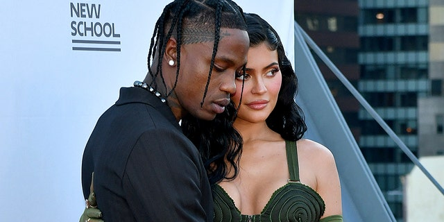 An onlooker said the 'Keeping Up with the Kardashians' star and the rapper were 'holding hands' during the Parsons event.